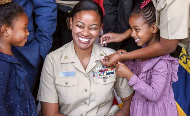 Daughters pin medals on mom